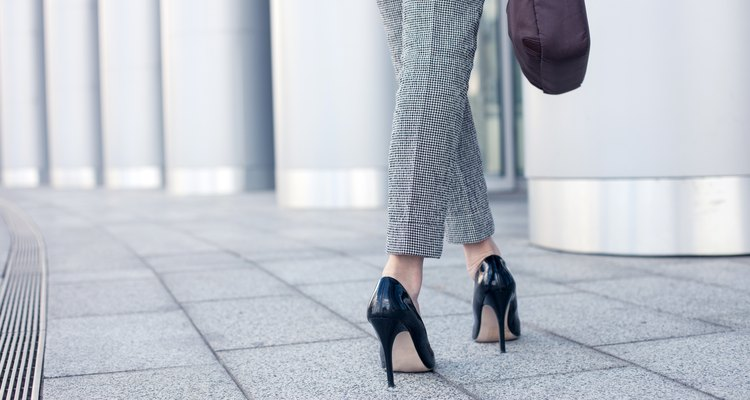 Elegant young businesswoman is going to work