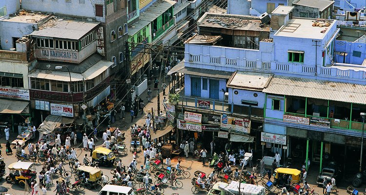 Auto rickshaws offer one way to thread through congested streets in Asian cities.
