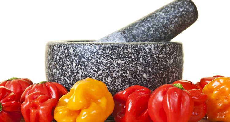 Mortar And Pestle With Scotch Bonnet Peppers