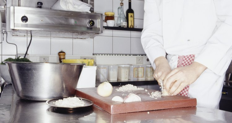 Chef preparing ingredients for meal, mid section