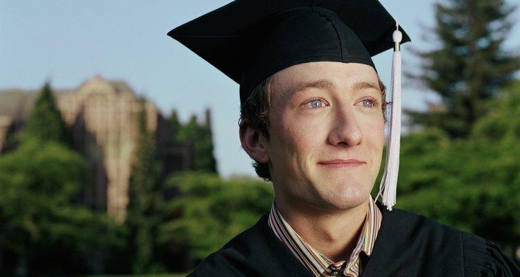 Graduate wearing cap and gown, portrait