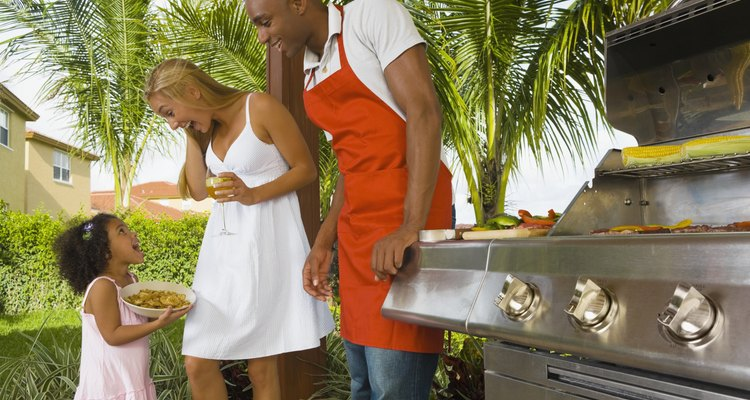 Mixed Race family barbecuing