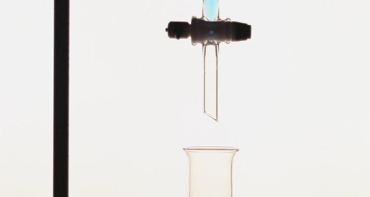 Burettes release precise amounts of solution into a beaker.