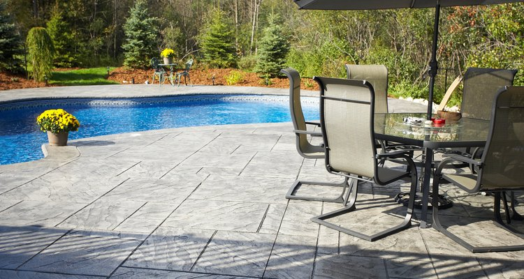 Stamped concrete is an inexpensive alternative to flagstone for a patio.