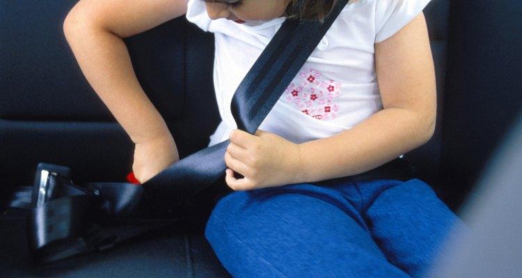 Girl buckling seatbelt
