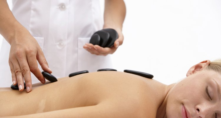 Young woman on treatment table receiving lastone therapy