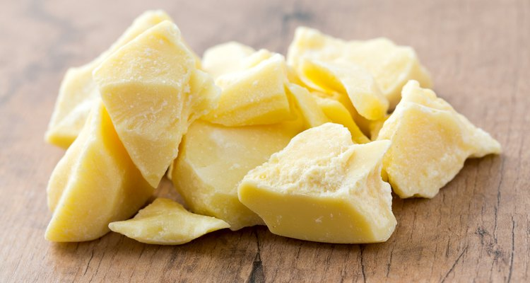 cocoa butter isolated on wooden surface