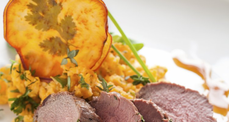 Roasted deer with smashed sweet potatoes and chips