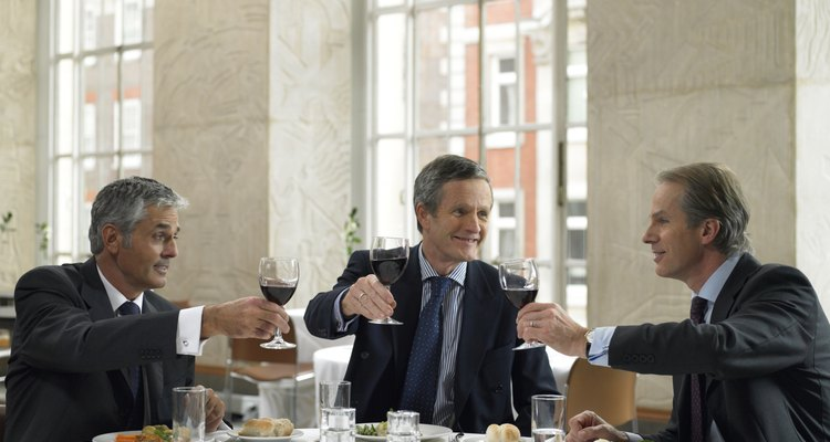 Business colleagues toasting in restaurant