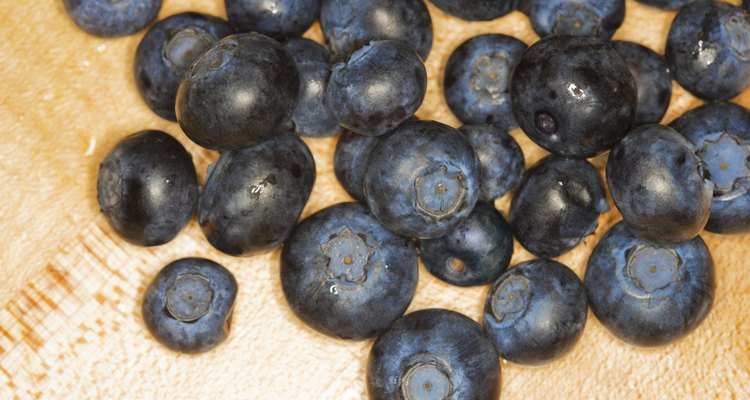 Blueberries on wood cutting-board