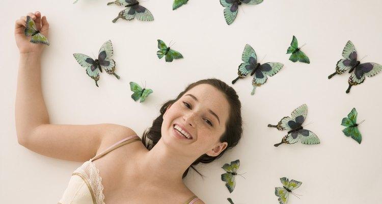 Woman lying by butterflies