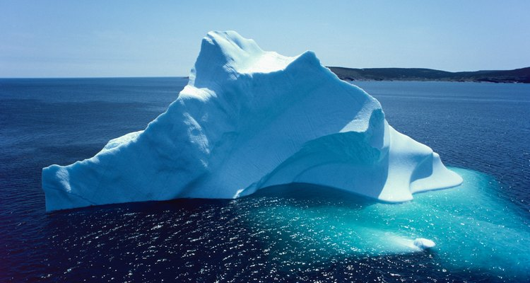 Only one-seventh to one-tenth of an iceberg's mass appears above the surface of the ocean.