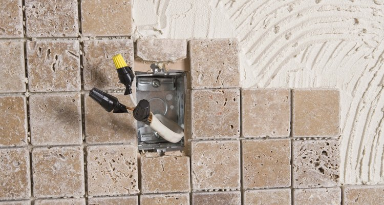 The capped off outlet show here was done so that tile and grout could be installed without the energised outlet in the way.