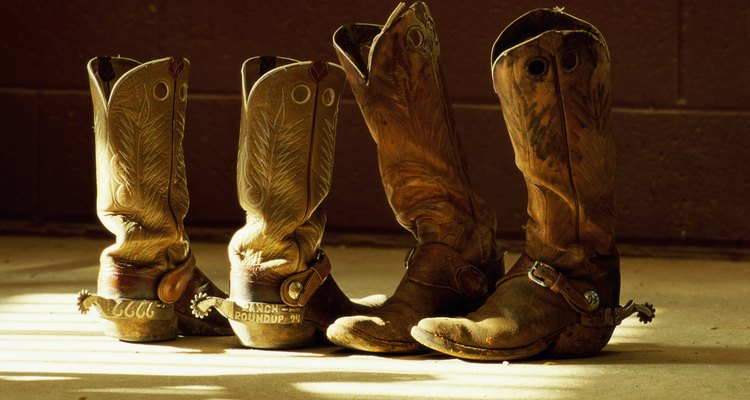 Close-up of two pairs of cowboy boots