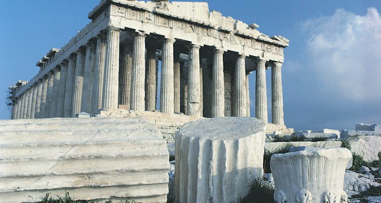 The Parthenon is a combination of Doric and Ionic architecture.  The thick Doric-style columns lack a base or volutes on the crown, but are fluted like Ionic columns.