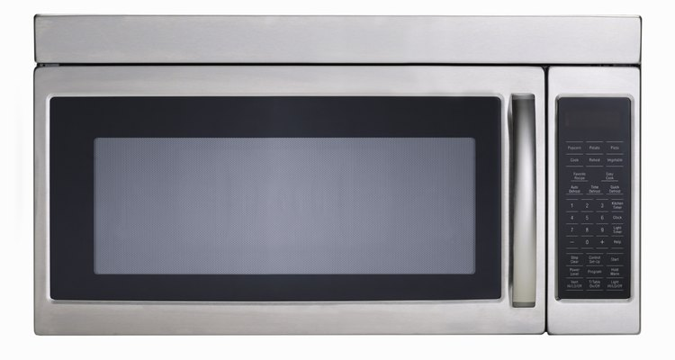 Use a metal self-etching spray primer on metallic microwaves.