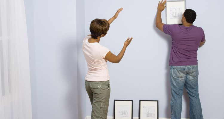 Hanging picures with a friend helps you get a second perspective.