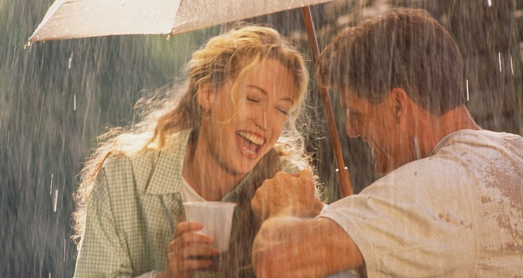 Having a picnic in the rain can still be fun and romantic.