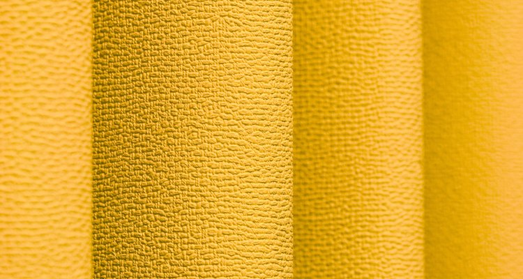 Use fabric to decorate vertical blinds.