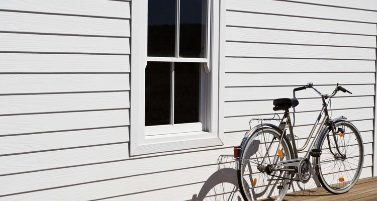 UPVC windows are cleaned with water and vinegar mixed in a sprayer.