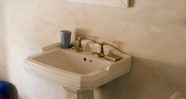 Some pedestal sinks come with a base that hides the plumbing.