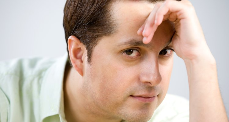 A new haircut can hide a prominent forehead or receding hairline.