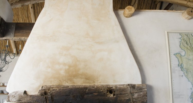 Simulate the look of wood ceiling beams with a simple faux finishing technique.