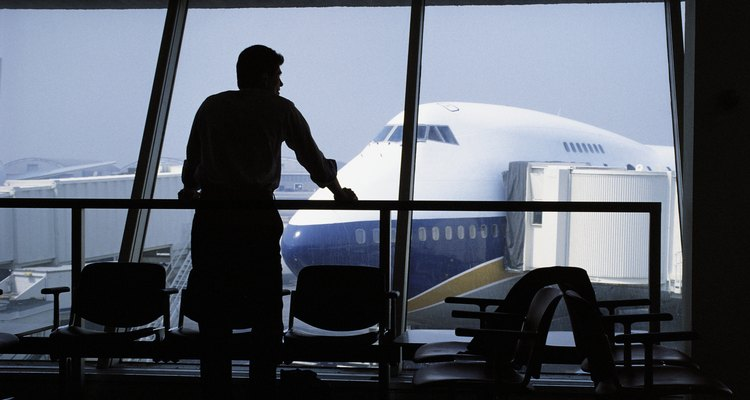Man waiting at airport gazing out window