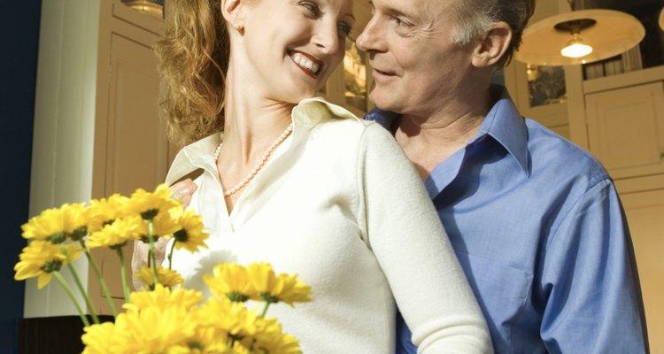 Couple arranging flowers