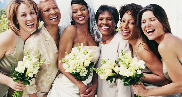 Portrait of Bride Standing With Mothers and her Bridesmaids