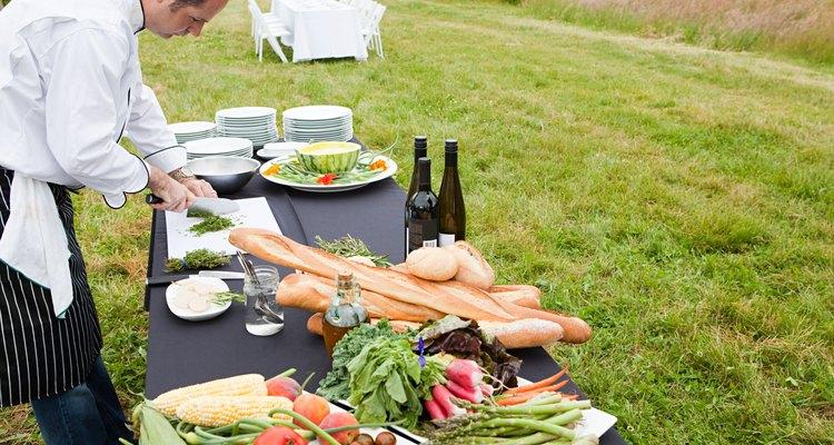 Chef preparing meal in a field