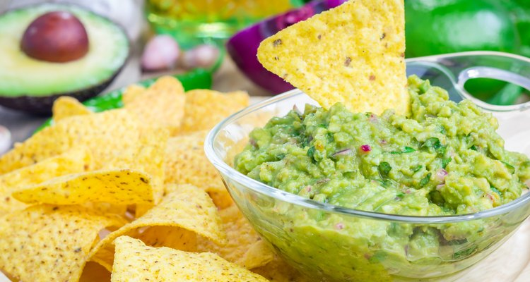 Bowl with chunky guacamole served with nachos