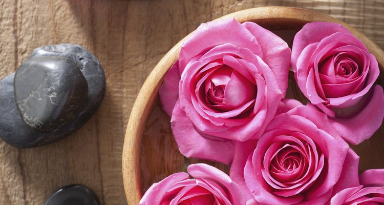 Roses provide beautiful additions to a bowl centrepiece.