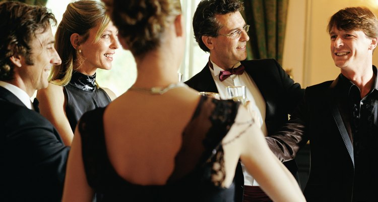 Group of people wearing formal attire indoors, smiling