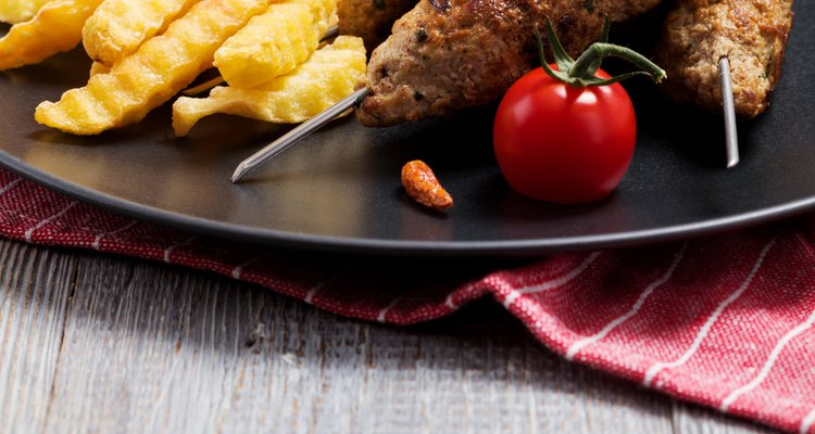 Barbecued kofta - kebeb with fries and vegetables