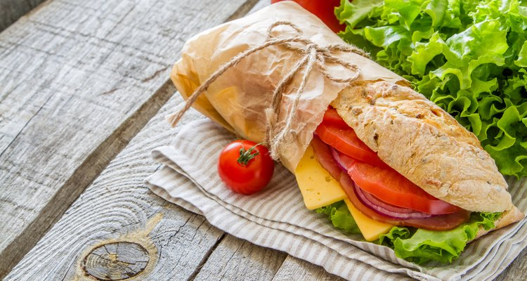 Summer sandwich with ham, cheese, salad and tomatoes, onion, juice