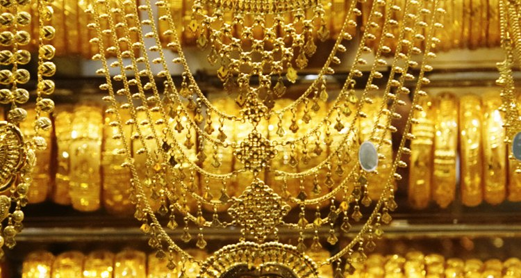Gold plating is when you deposit a thin layer of gold onto the surface of another metal