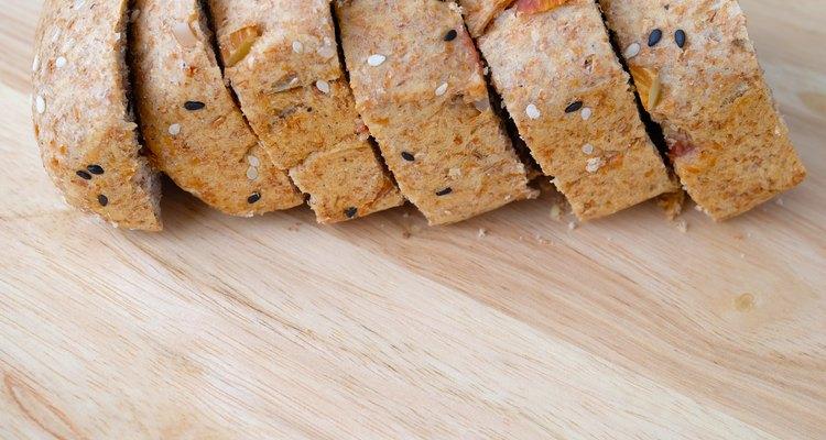 Sliced bread on wood background