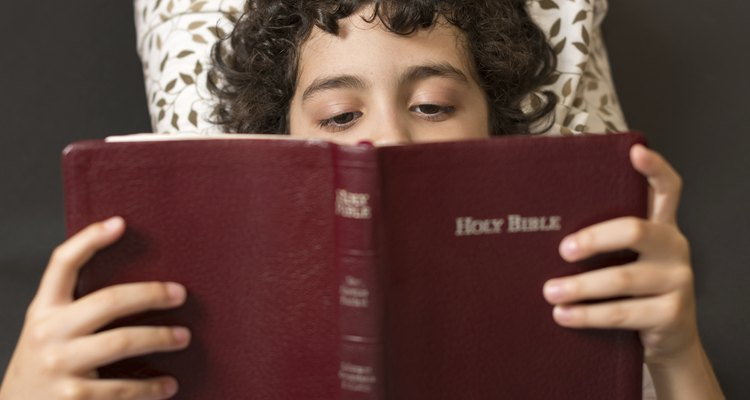 Hispanic boy reading the bible