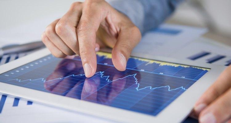 Informe del mercado financiero escrito con bolígrafo.