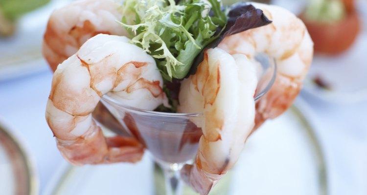 Shrimp cocktail served in stem glass
