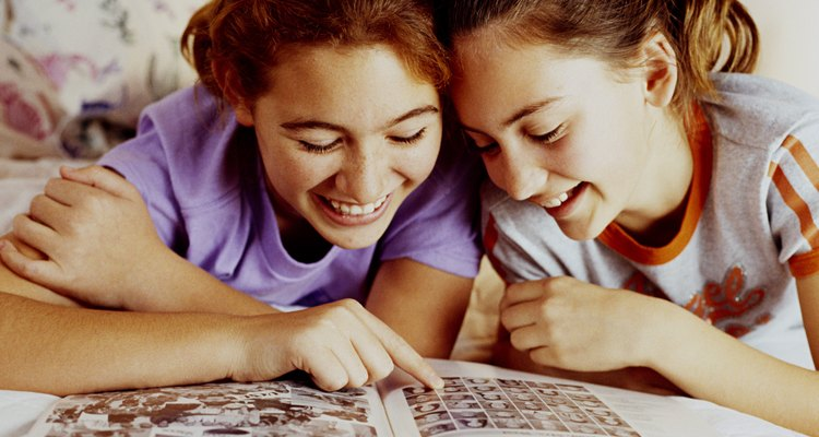 Girls looking at yearbook