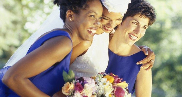 Bride with bridesmaids standing in garden