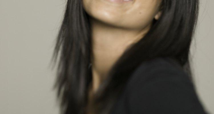 Woman with dark hair and dark eyes, posing in studio, portrait