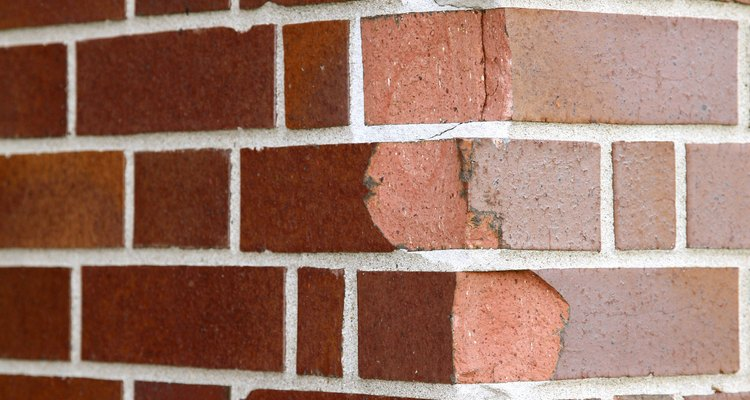 Avoid damage to brick walls by installing ledger boards. to distribute weight.