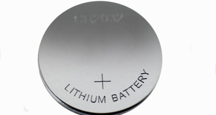 One side of a button cell battery is always marked with a