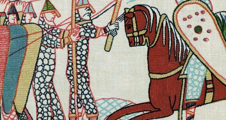 Uma peça da tapeçaria Bayeux mostrando cavaleiros com escudos pipa