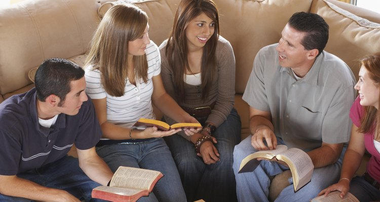 Youth group with pastor in Bible study