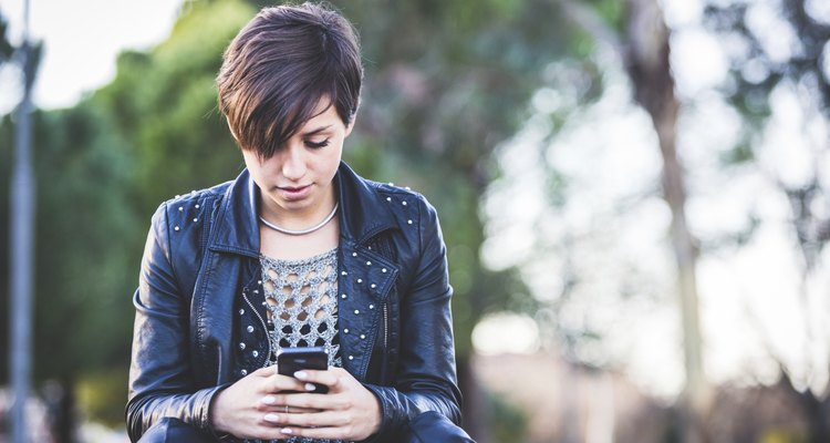 Girl Typing on Mobile Phone