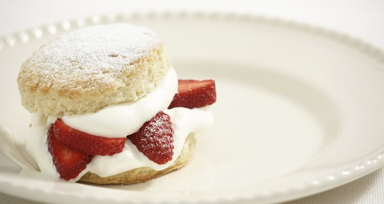 Clotted cream typically accompanies tea and a scone